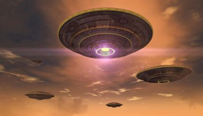 A depiction of four UFOs hovering in an evening sky