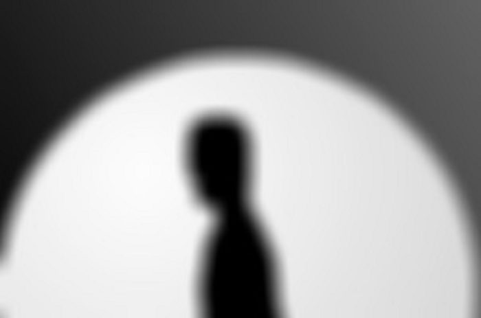 An image of a shadowy figure