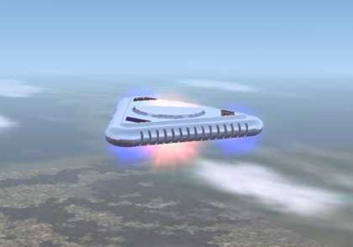 An image of a silver triangle UFO high in the sky