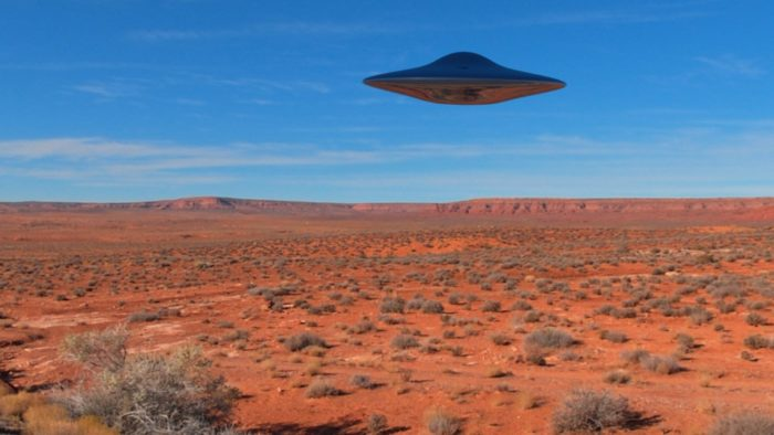 A superimposed UFO over a desert