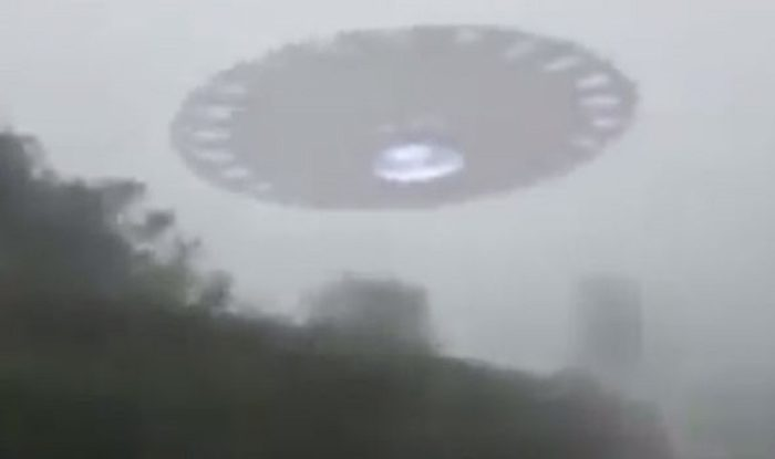 Impression of a UFO hovering in a misty sky
