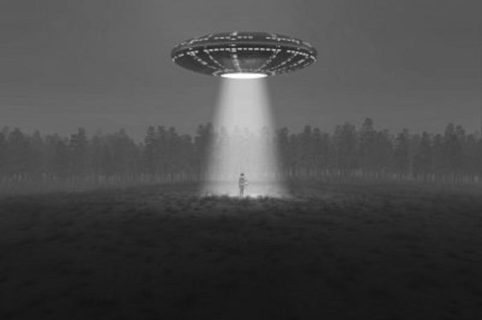 A depiction of a UFO shining a bright light into a field