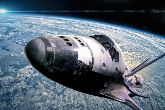 An image of a space shuttle high above the Earth