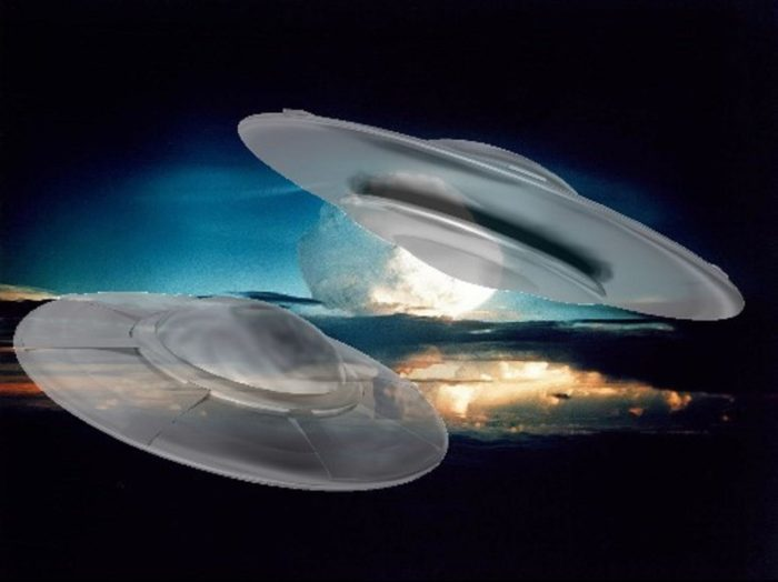 Two superimposed UFOs over an image of a nuclear mushroom cloud