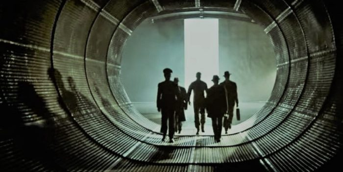 A depiction of military officers walking through a secret tunnel
