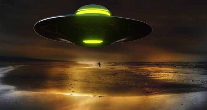 A superimposed UFO on a night beach