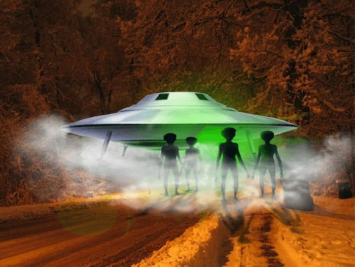 A depiction of a UFO on a road with aliens emerging from it