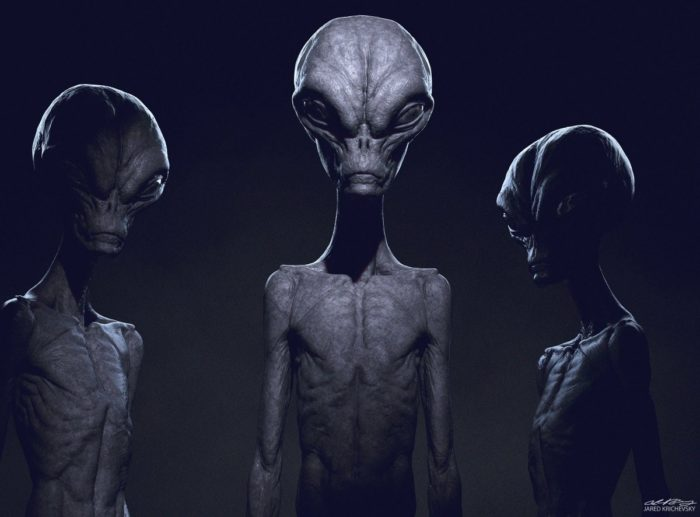 A depiction of three grey aliens