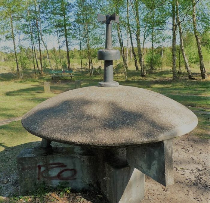 A stone monument of a saucer shaped UFO
