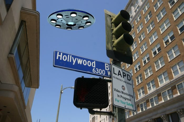 A UFO superimposed onto a ground shot of a Hollywood street