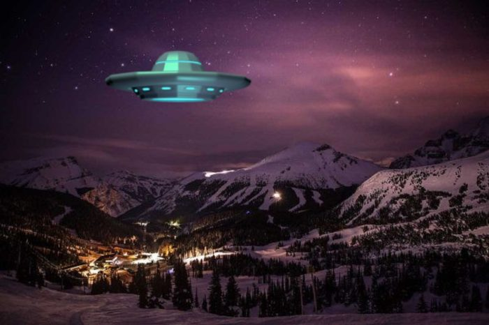 A UFO superimposed on a picture of lodge setting at night