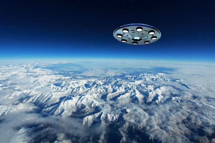 A UFO superimposed on to an aerial picture of the mountains