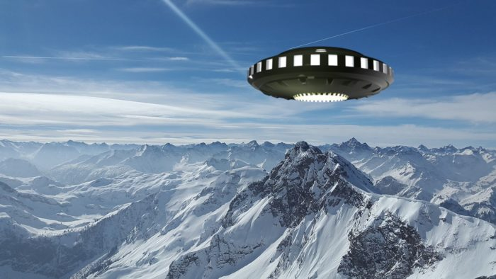 A UFO superimposed on a picture of a snowy mountaintop