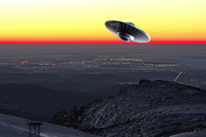 A UFO superimposed onto a picture of sunset sky