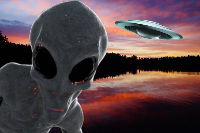 A depiction of an alien and a UFO over a lake at sunset