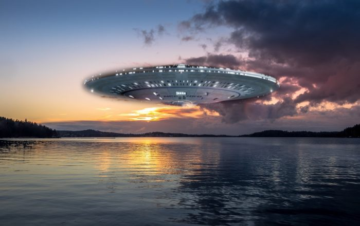 A superimposed UFO over a picture of a lake