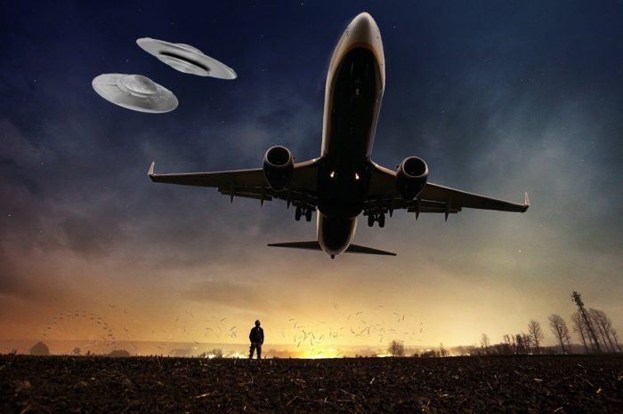A picture of a plane coming into land with two superimposed UFOs in the background