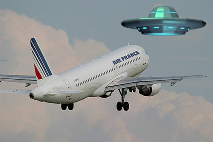 A picture of an Air France plane taking off with a superimposed UFO over the top
