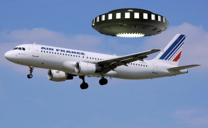 a picture of an Air France plane with a UFO superimposed over the top