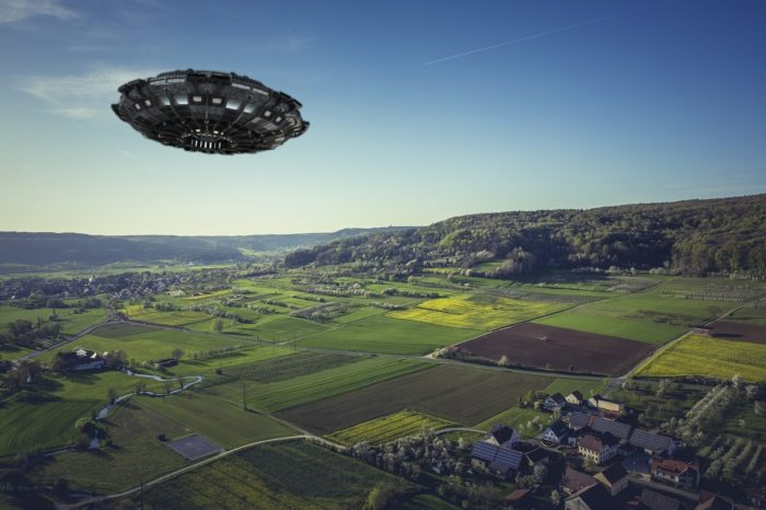 A superimposed UFO over an aerial picture of fields