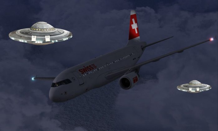A picture of a Swiss plane with two superimposed UFOs in the background
