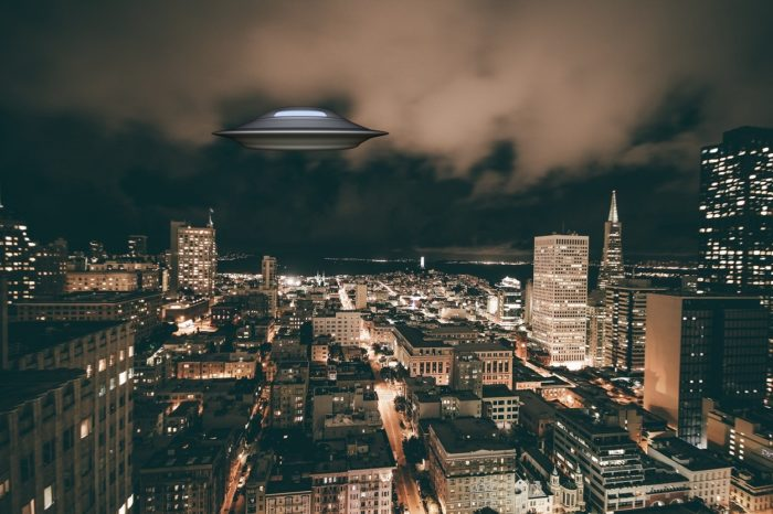 A superimposed UFO on a picture of city at night