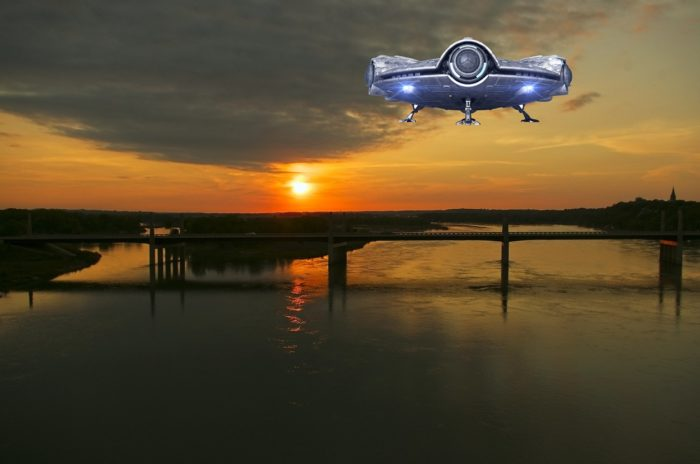 A superimposed UFO on a picture of a river at sunset