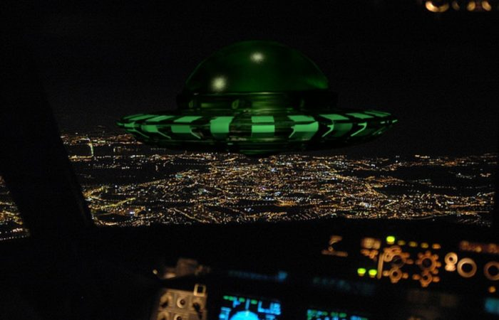 A superimposed UFO on a picture of a cockpit view