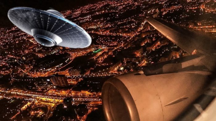 A picture of an aerial view of a plane with a superimposed UFO over the top