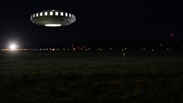 A superimposed UFO on a picture of a field at night