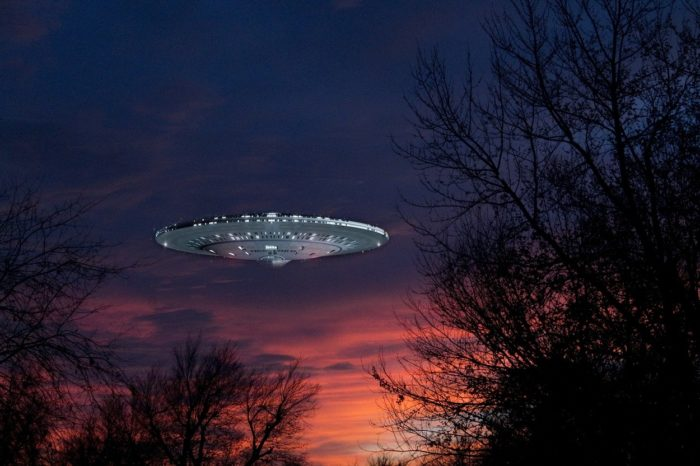 A superimposed UFO on a picture of a sunset sky