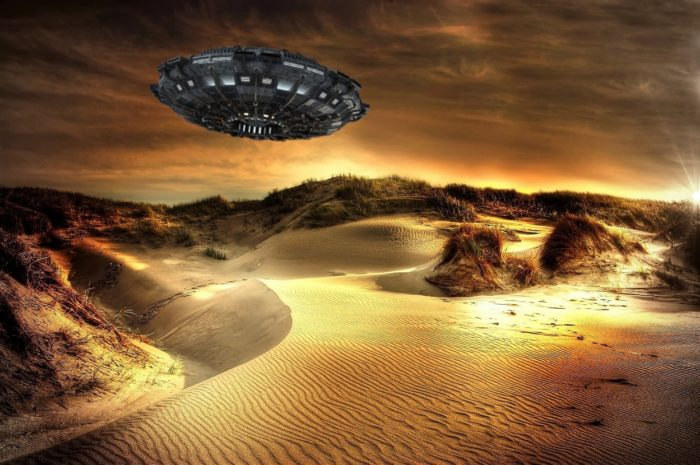 An image of a UFO over a sandy landscape