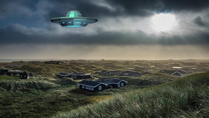 A superimposed UFO over an image of a small country village