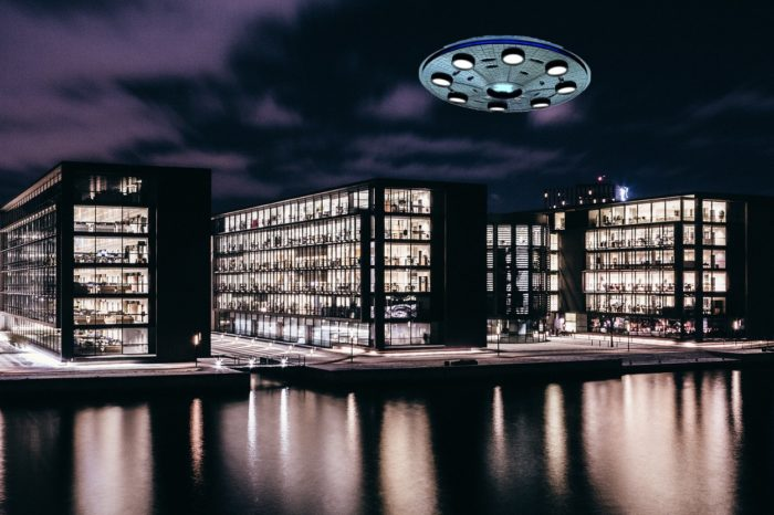 A superimposed UFO over a block of flats at the waterside