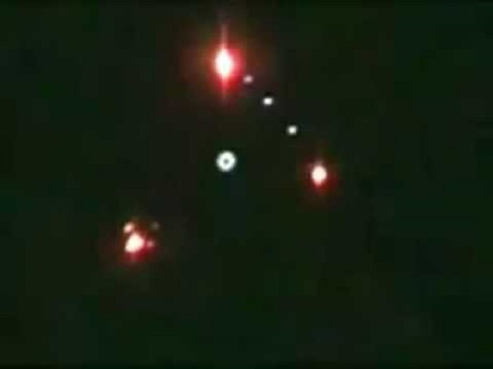 A picture taken directly below an alleged triangular UFO with lights at each corner