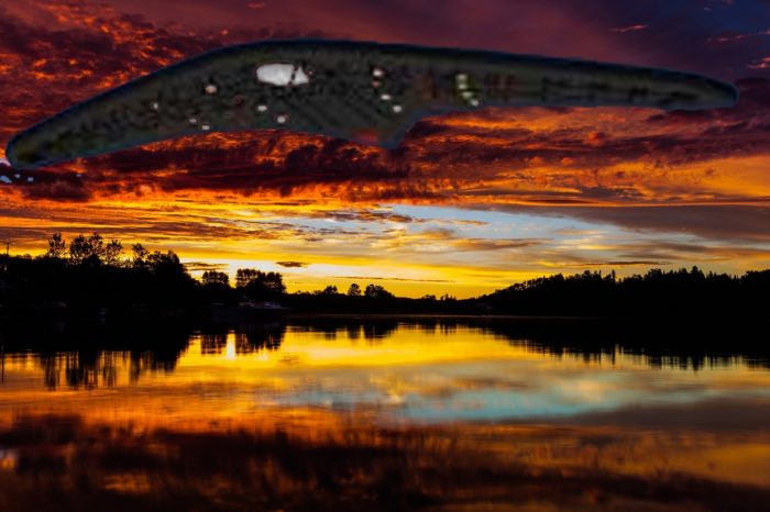 A depiction of a UFO over the water at sunset