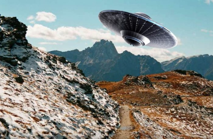 A superimposed UFO over a daytime mountain scene
