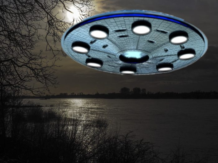 A superimposed picture of a UFO over a river