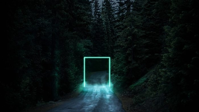 A superimposed portal onto a lonely forest road