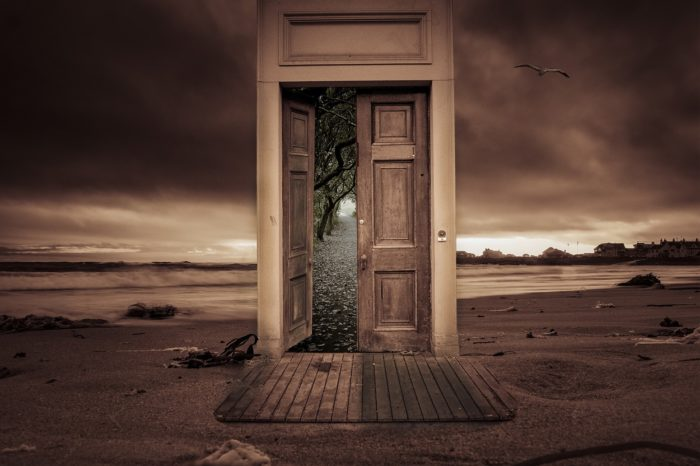 A mystical image of a door in the middle of desert