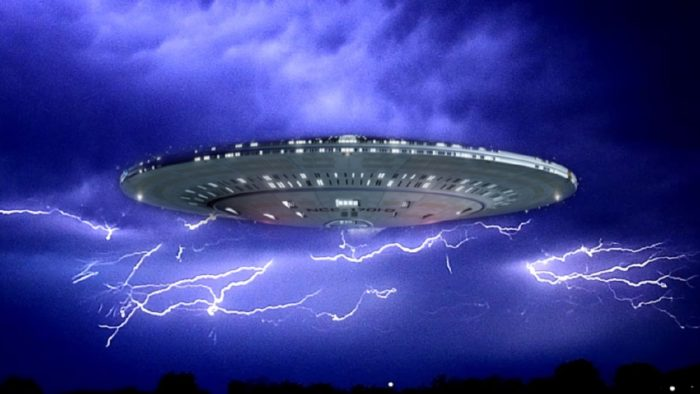 An image of a UFO superimposed onto to a night sky with lightning