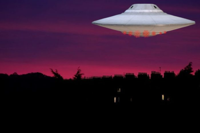 An image showing a UFO over a picture of an evening sky