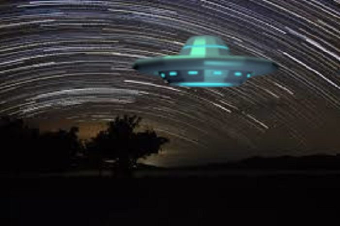 An image of a UFO over a time-lapsed night sky