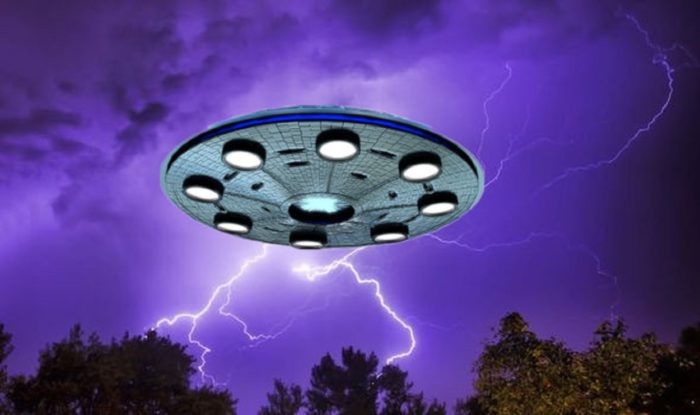 An image of a UFO over a night sky with lightning bolts