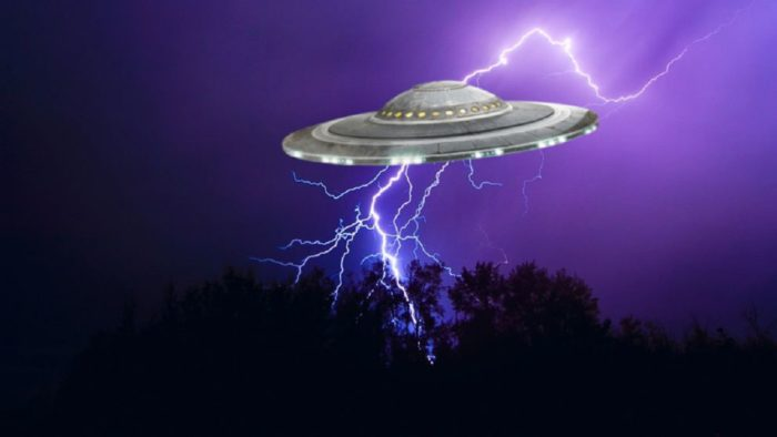 A superimposed UFO onto a lightning covered sky