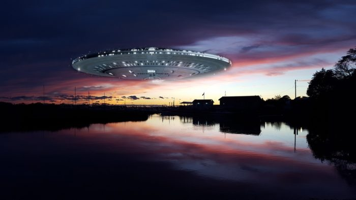 A superimposed UFO onto a picture of sunset river