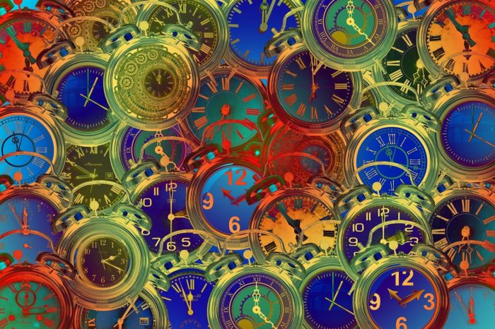 An image of multicolored clocks