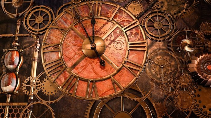 A close up of clock with several dials and cogs