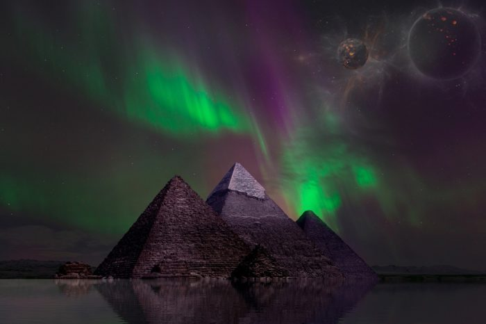 A picture of the pyramids with an aurora sky