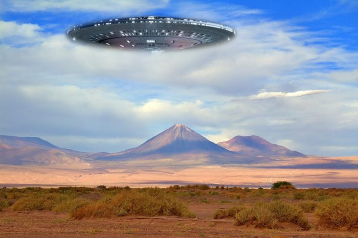An image showing a flying saucer over mountains